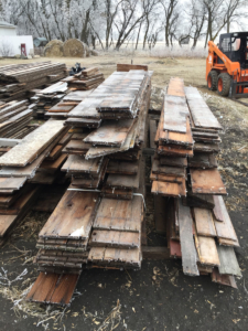piles of salvaged barn wood